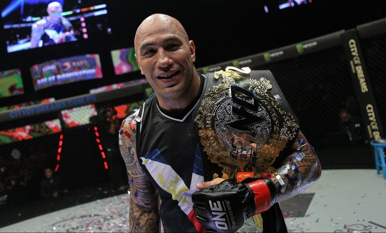 brandon vera with one heavyweight world championship belt