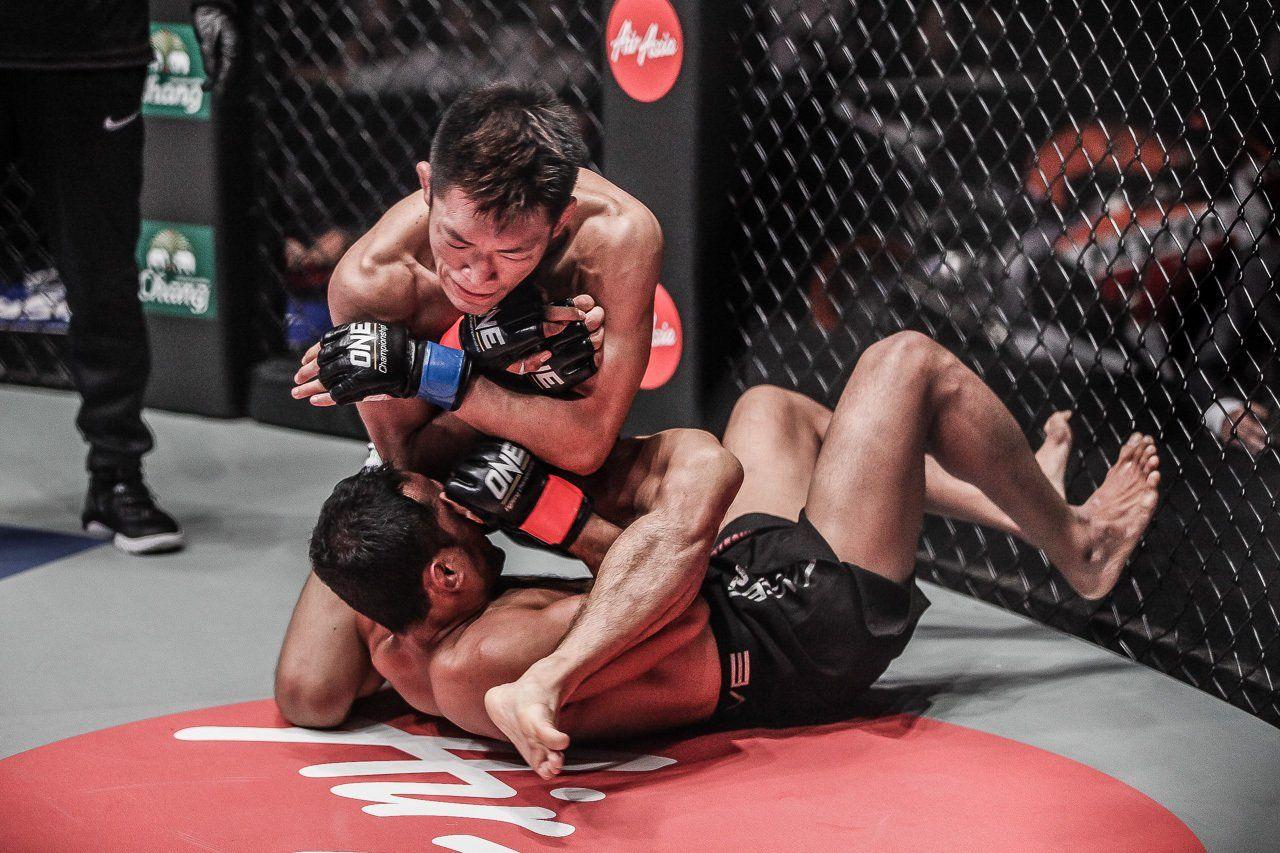 Japanese mixed martial artist Yoshitaka Naito attempts an armbar in his debut