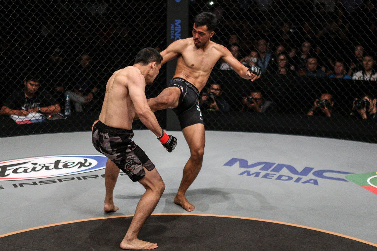 Mario Satya Wirawan connects with a hard leg kick on Yohan Mulia Legowo at ONE: TRIBE OF WARRIORS in Jakarta. Global MMA News