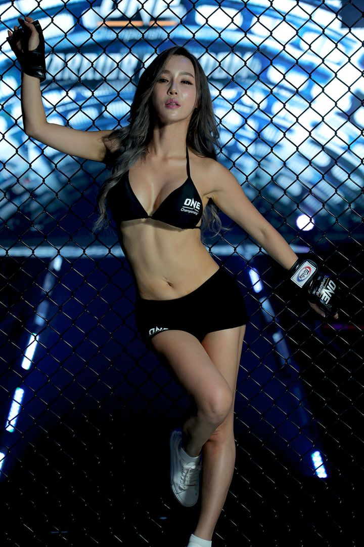 ONE Championship ring girl DJ Jina holds onto the cage