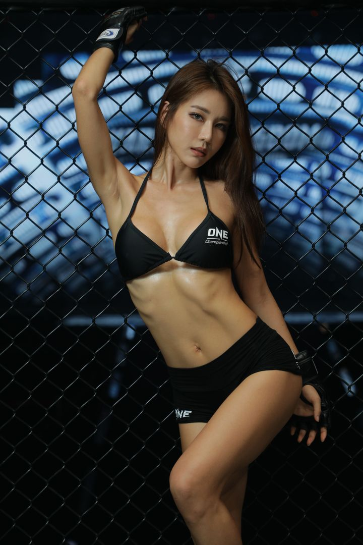 ONE Championship ring girl Siena poses against the cage