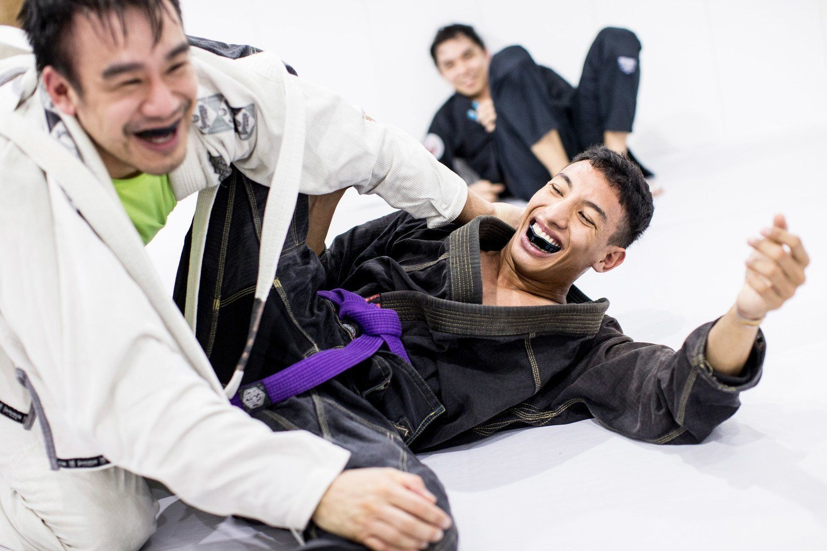 BJJ practitioners at a Singapore gym wear mouthguards