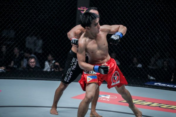 Filipino mixed martial artist Joshua Pacio attempts the spinning back fist