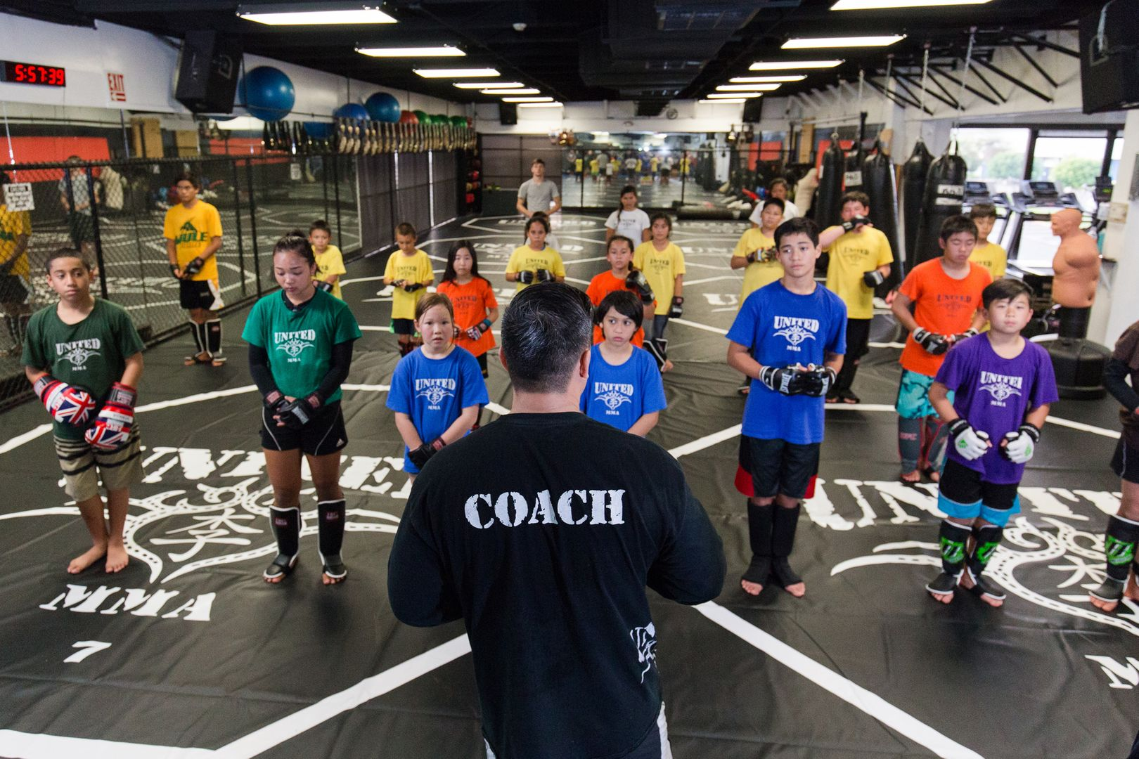 Ken Lee teaches children at United MMA