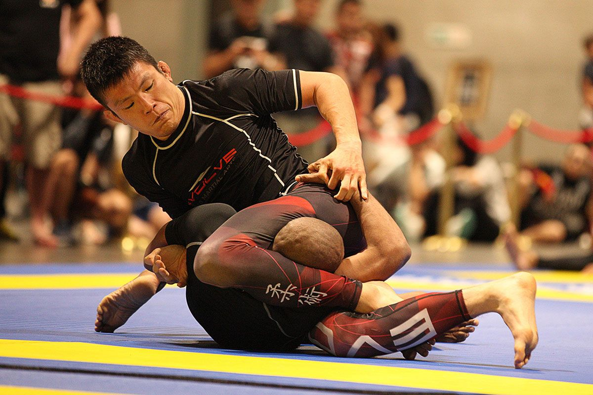 Former ONE Lightweight World Champion Shinya Aoki wears a rash guard during a grappling bout