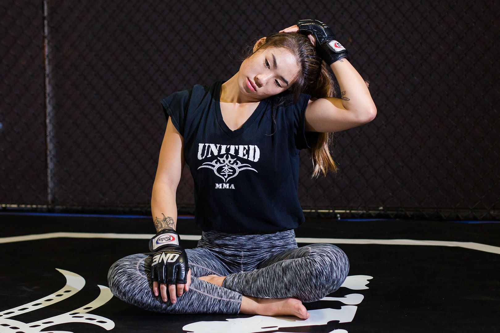 Angela Lee stretches her neck at United MMA in Hawaii