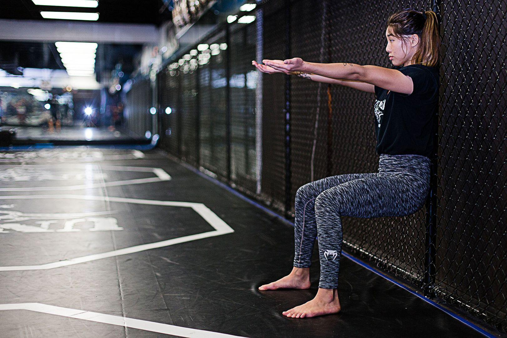 ONE Women's Atomweight World Champion Angela Lee performs a wall sit