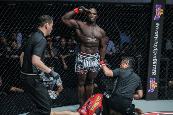 Hong Kong MMA fighter Alain Ngalani salutes after his record-setting win
