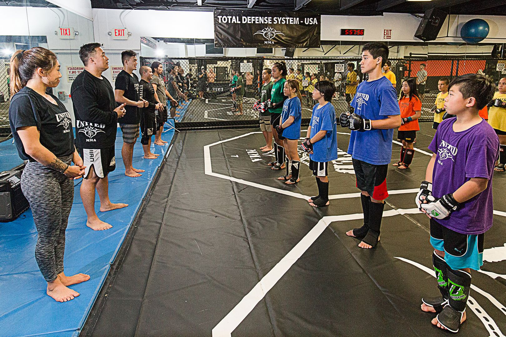 Angela Lee, Christian Lee, and Ken Lee teach kids at United MMA