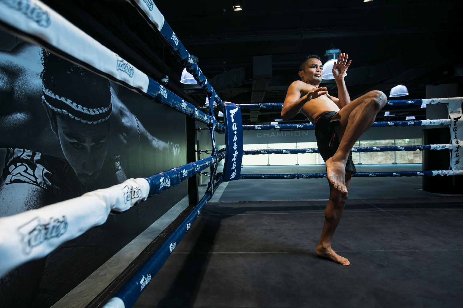 Former ONE Strawweight World Champion Dejdamrong Sor Amnuaysirichoke shadow boxes and throws an air knee