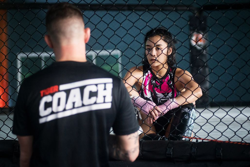 Tiger Muay Thai Head Coach George Hickman speaks with rIka Ishige after a training session