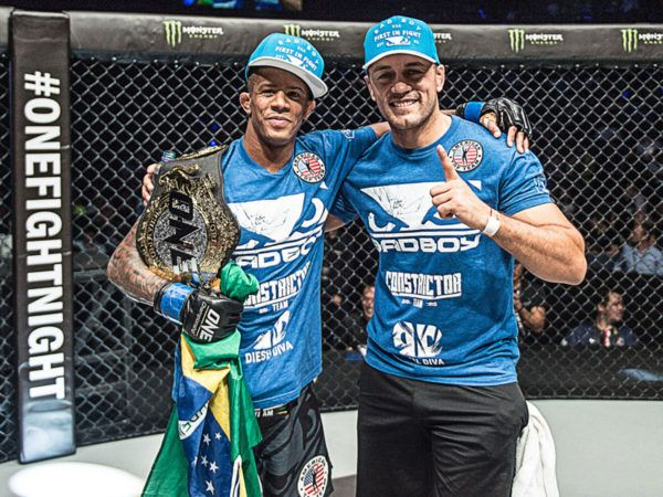 ONE Flyweight World Champion Adriano Moraes poses with the belt