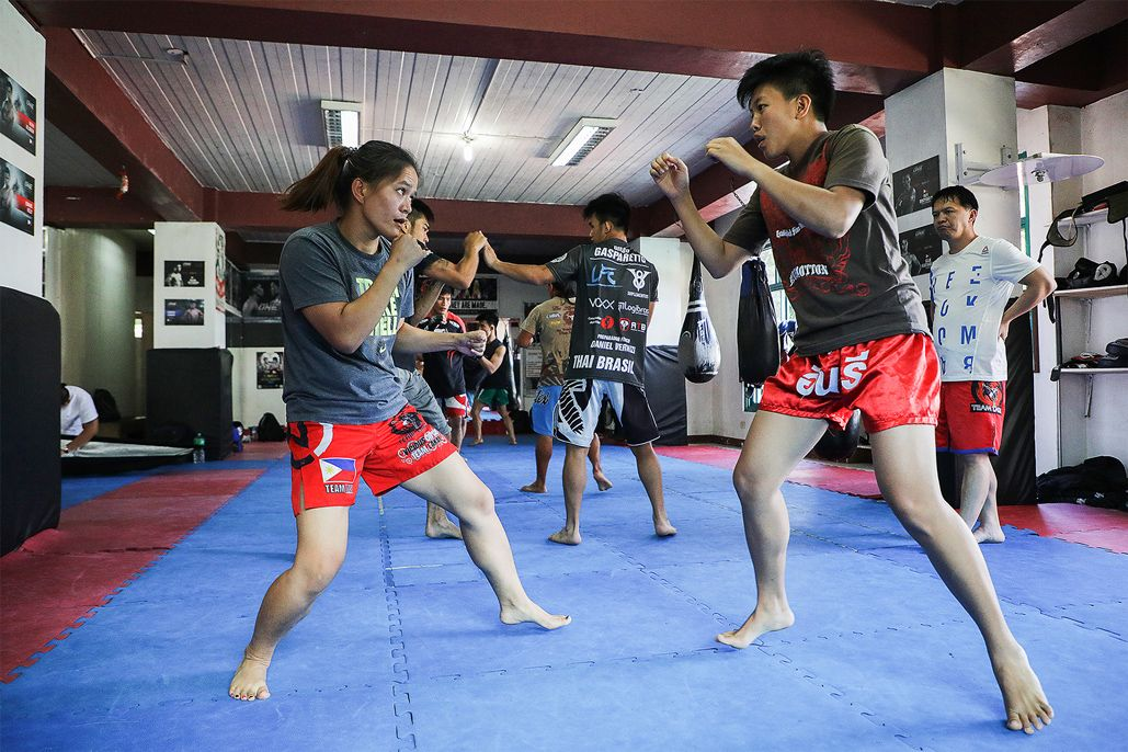 MMA fighters Gina Iniong and April Osenio train at Team Lakay