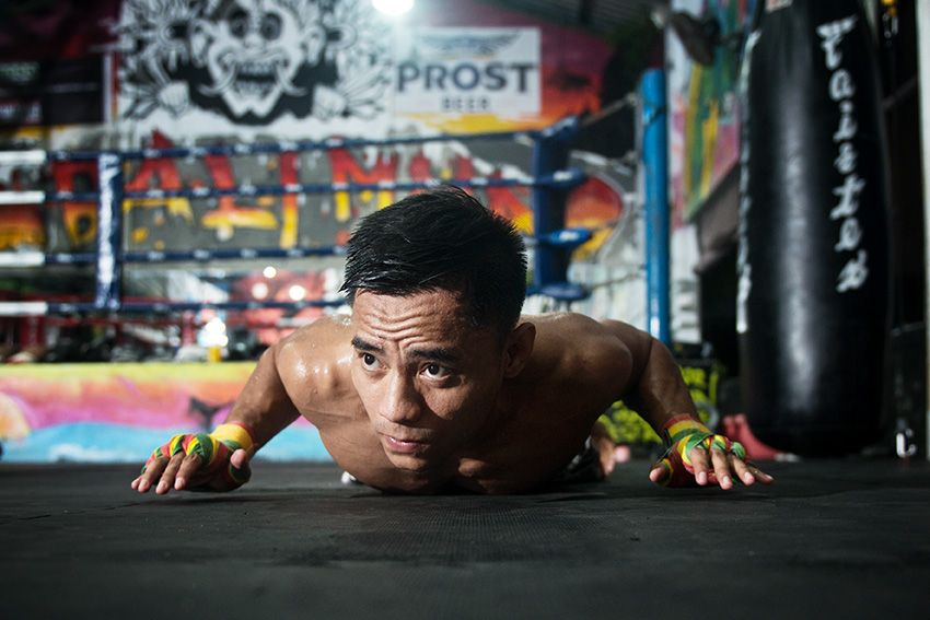 ONE Championship strawweight contender Stefer Rahardian performs a push-up
