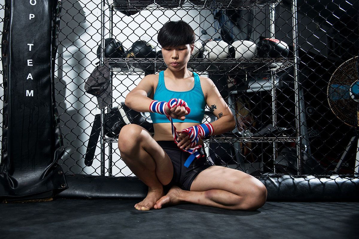 ONE Women's Strawweight World Champion Xiong Jing Nan wraps her hands at the Phuket Top Team gym in Thailand