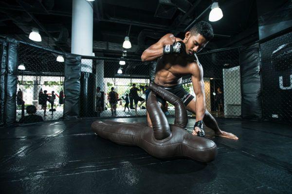Singaporean mixed martial artist Amir Khan punches a dummy
