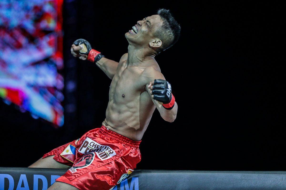 Filipino MMA fighter Edward Kelly celebrates a victory