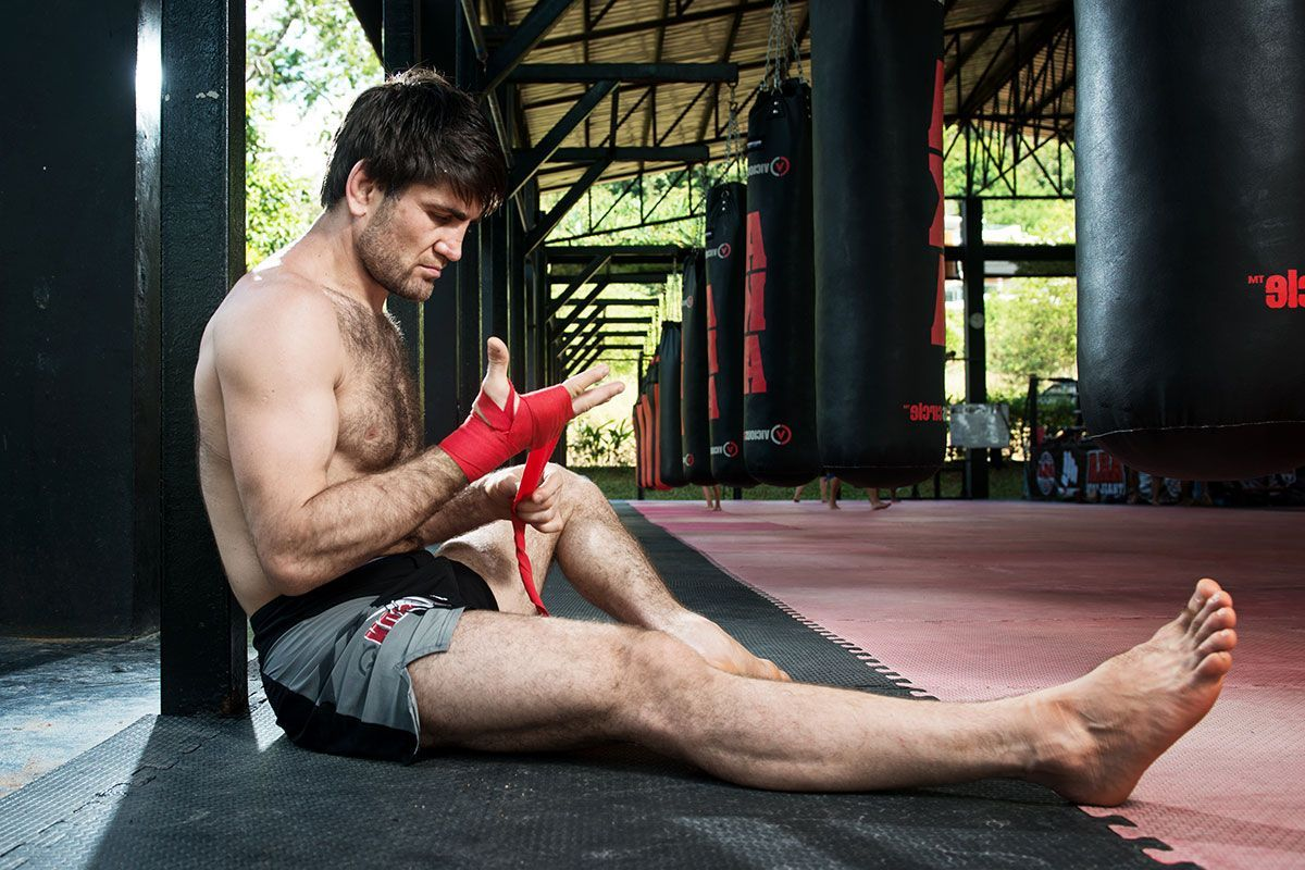 Former ONE Featherweight World Champion Marat Gafurov wraps his hands