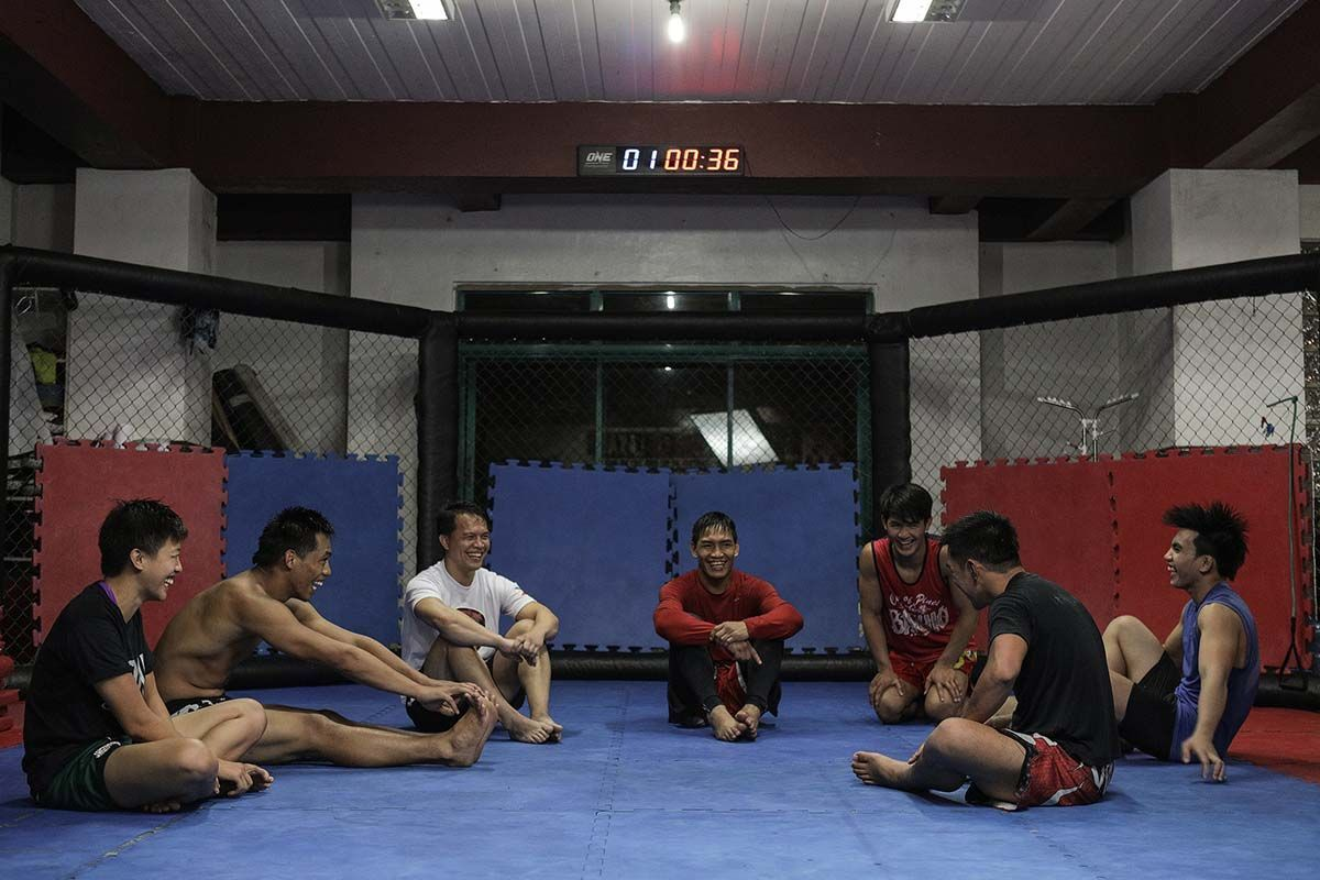 Team Lakay athletes relax in the gym