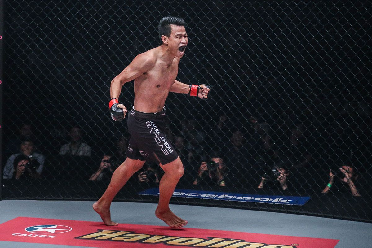 Muay Thai legend Sagetdao Petpayathai runs around the Circle after earning a knockout victory