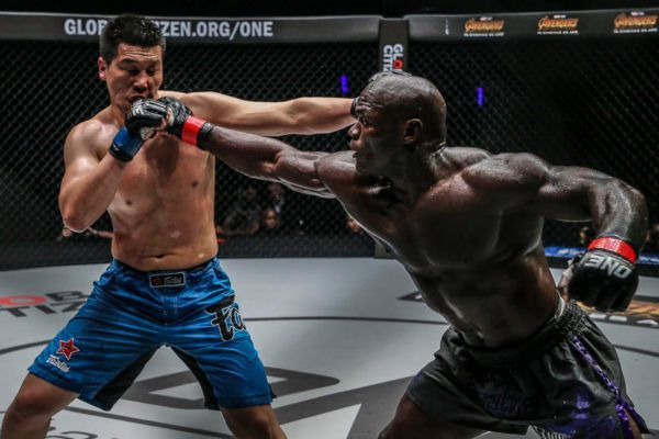 Hong Kong MMA fighter Alain Ngalani darts forward with a punch