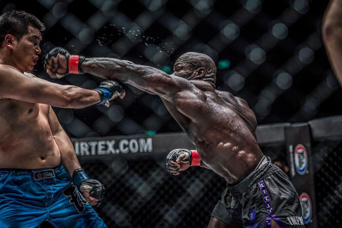 Hong Kong-based mixed martial artist Alain Ngalani throws a left hook