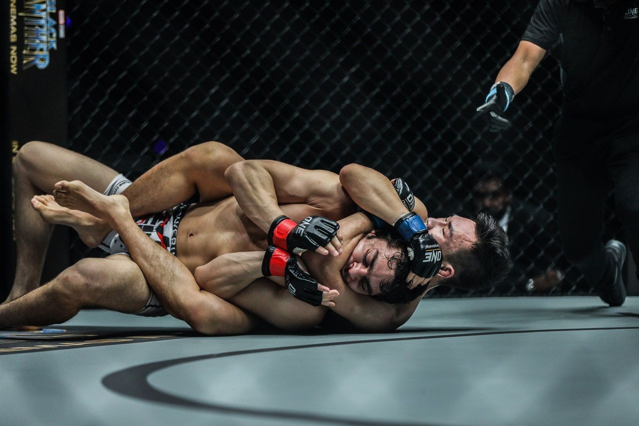 Chinese hero Ma Jia Wen locks in a rear-naked choke, but applies pressure on the jaw