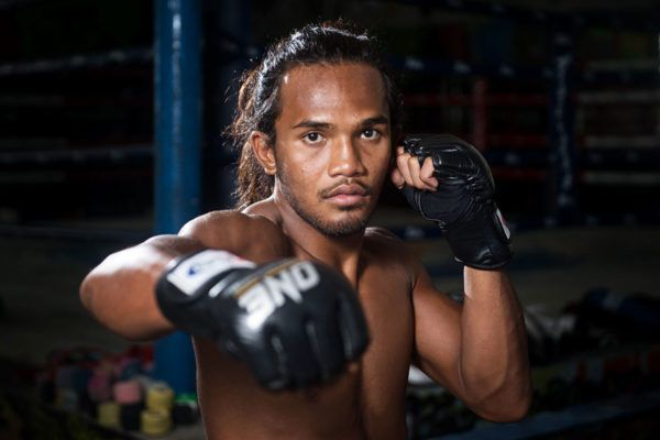 Malaysian martial artist Muhammad Aiman shows off his ONE Gloves