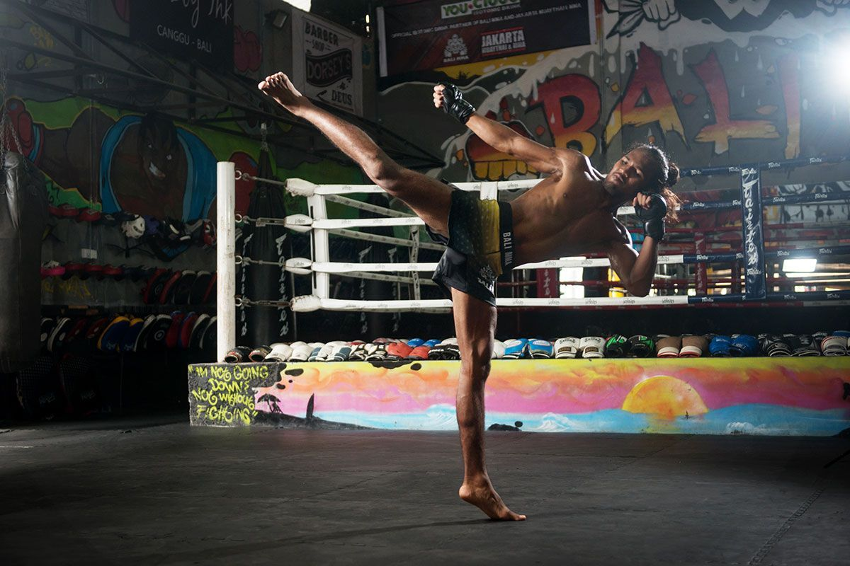 Malaysia's Muhammad Aiman throws a high kick during his training camp shoot