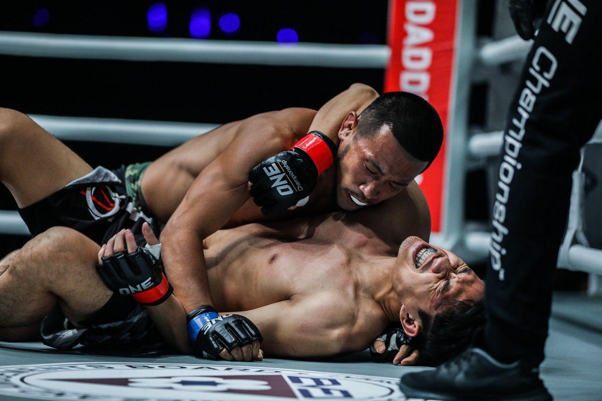 Japanese mixed martial artist Akihiro Fujisawa takes top position