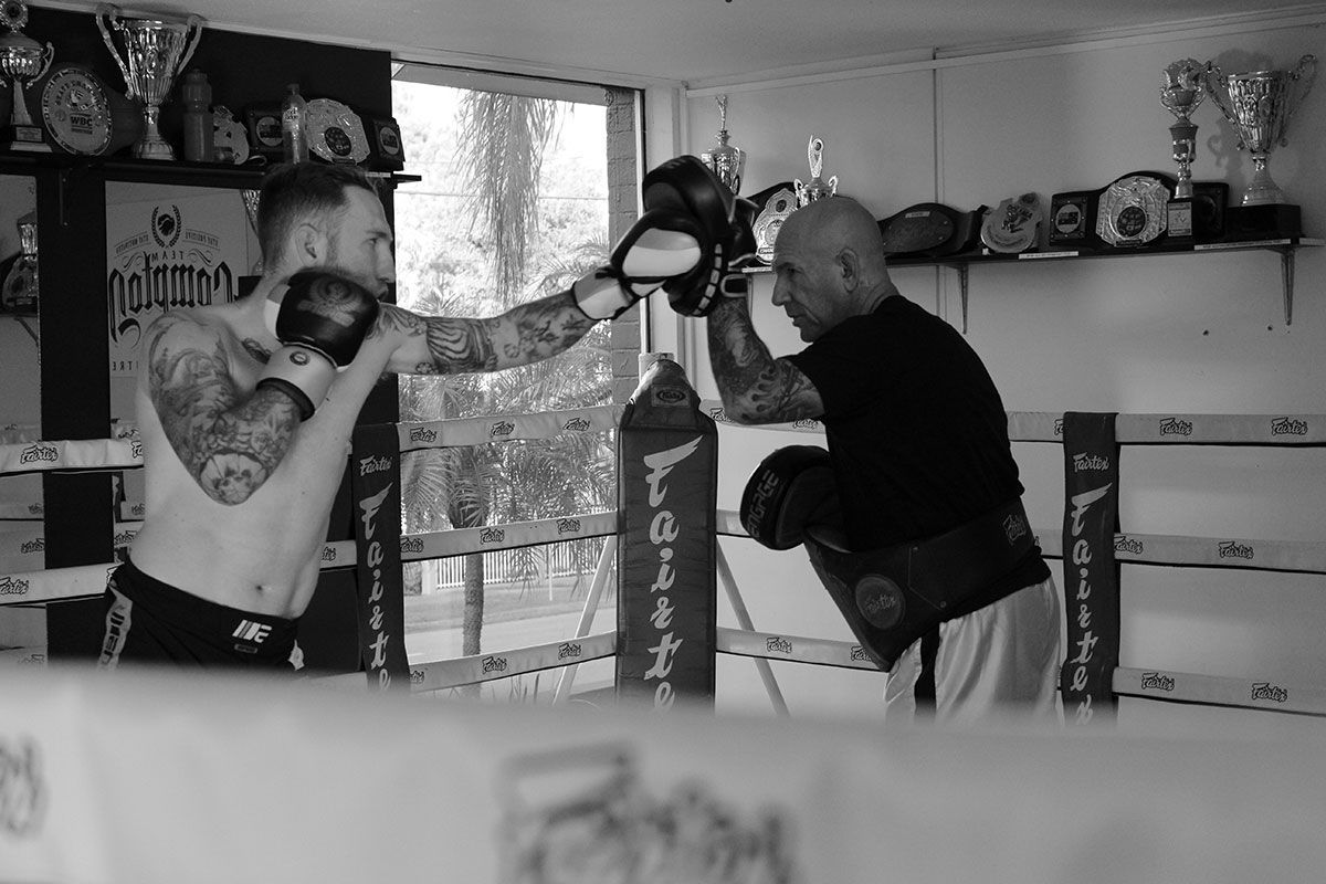 Elliot Compton hits pads with his dad