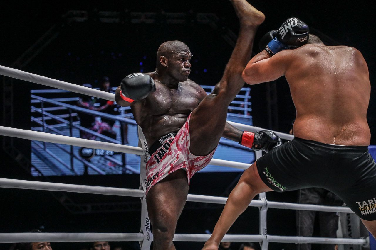 Alain Ngalani attempts an axe kick with ease due to his incredible flexibility.