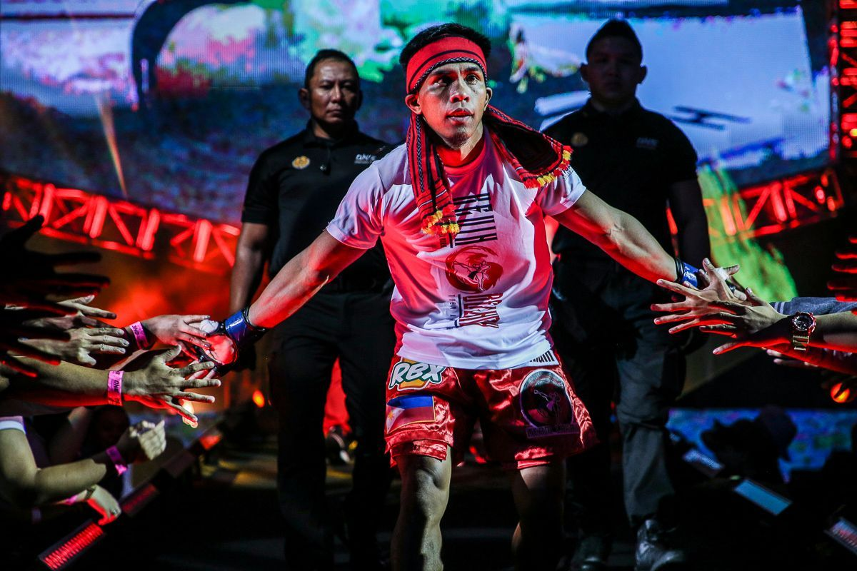 Filipino MMA star Kevin Belingon enters the arena