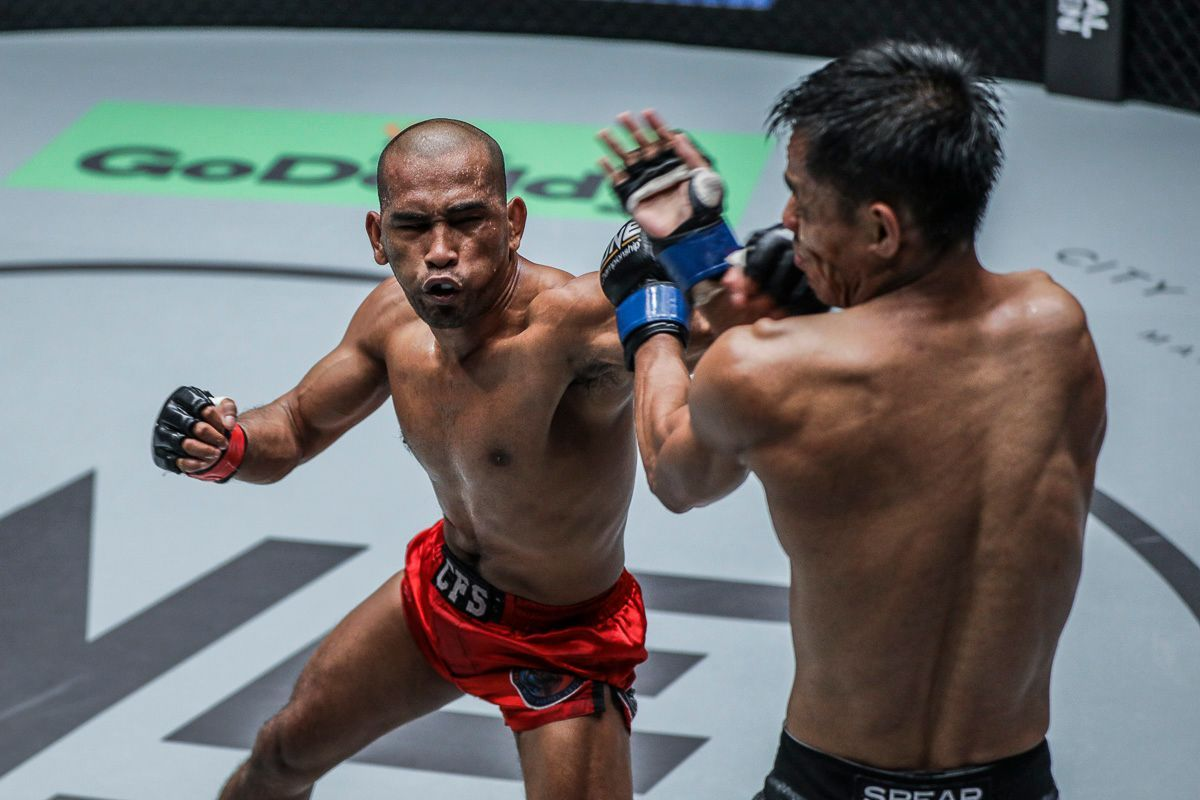 Philippine martial artist Rene Catalan leaps forward with a punch