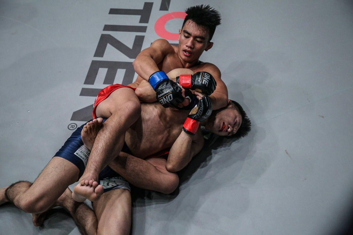 Joshua Pacio out-grappled Yoshitaka Naito to win the ONE Strawweight World Title