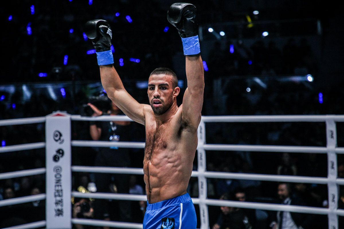 Italian kickboxer Mustapha Haida raises his arms in the ring