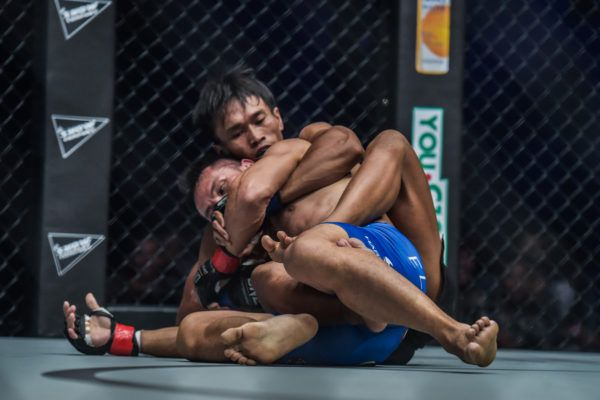Sunoto works to sink in a rear-naked choke at ONE: CONQUEST OF HEROES against Victorio Senduk.
