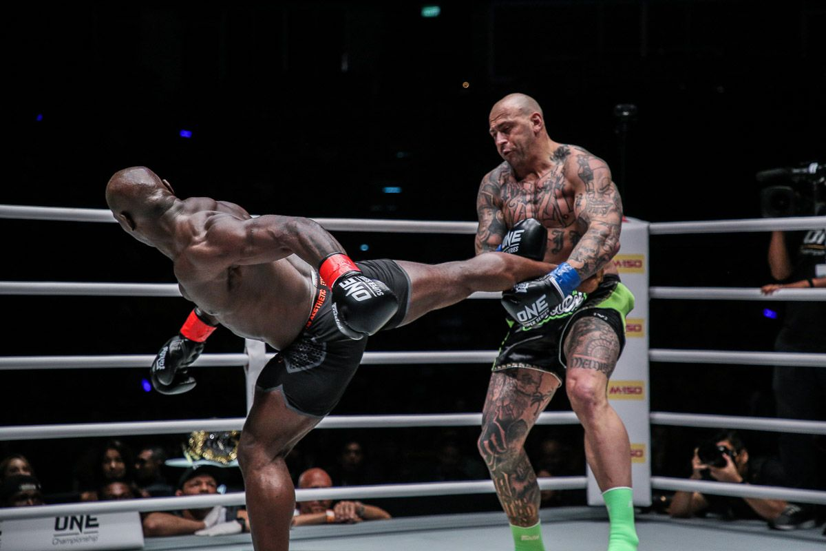 Four-time Heavyweight World Champion Alain Ngalani hits a spinning back kick in October 2018