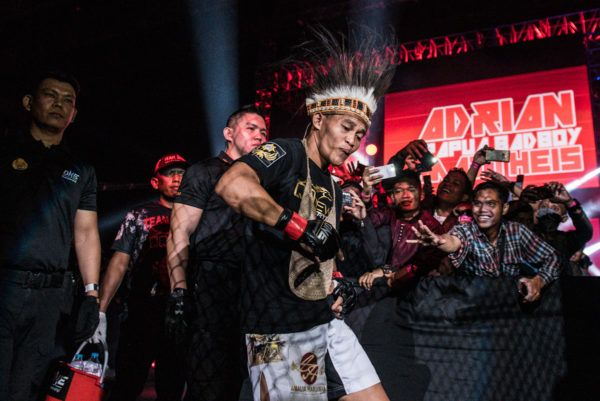 Indonesian mixed martial artist Adrian Mattheis displays some swagger on the way to the ring