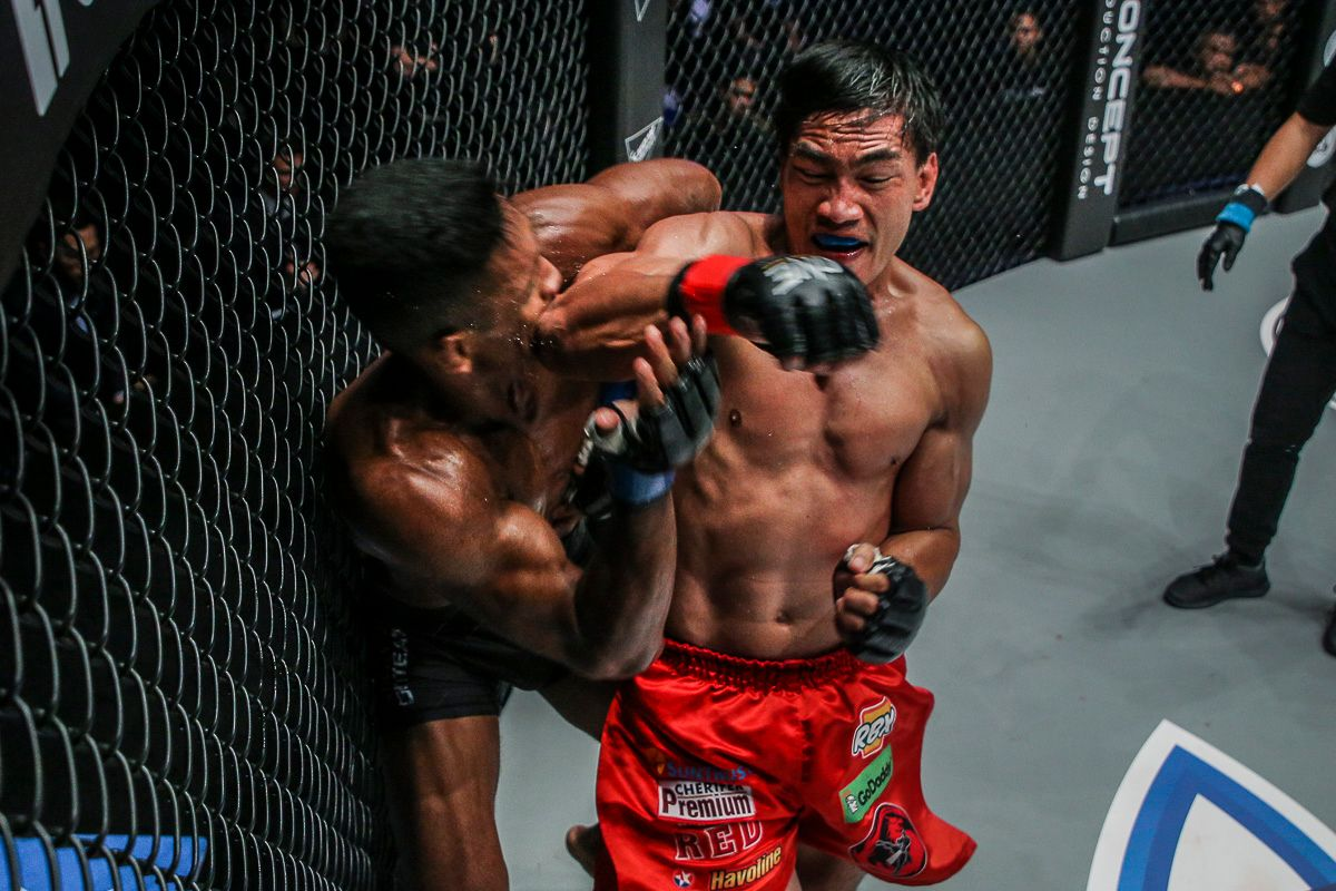 Eduard Folayang lands a spinning back elbow on Amir Khan on their ONE Lightweight World Title encounter