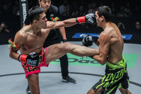 Muay Thai fighter Saemapetch Fairtex kicks and punches Alaverdi Ramazonov
