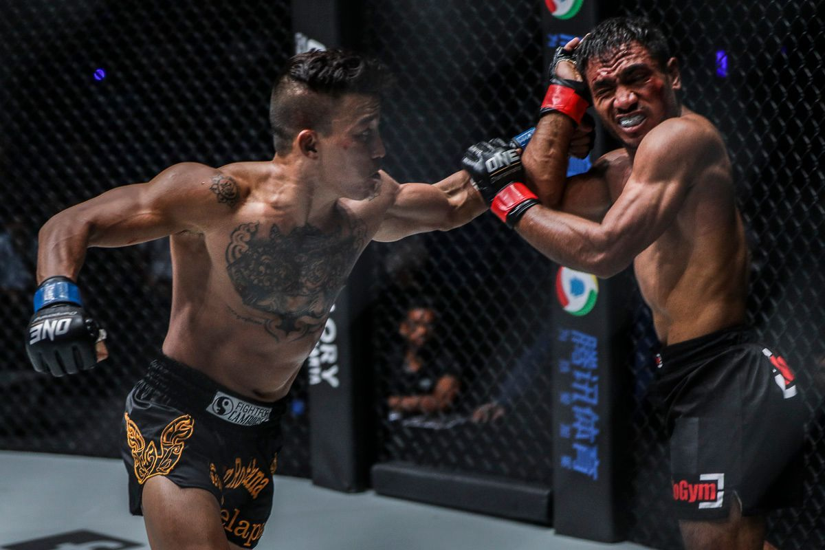 Cambodian MMA fighter Chan Rothana punches Abro Fernandes