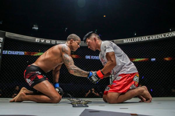 Flyweight mixed martial artist Adriano Moraes and Geje Eustaquio show respect to each other following their battle
