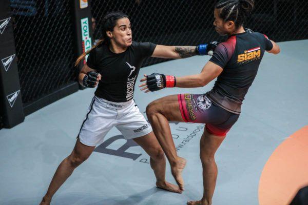 Indian mixed martial artist Puja Tomar unloads a straght left o Priscilla Hertati Lumban Gaol