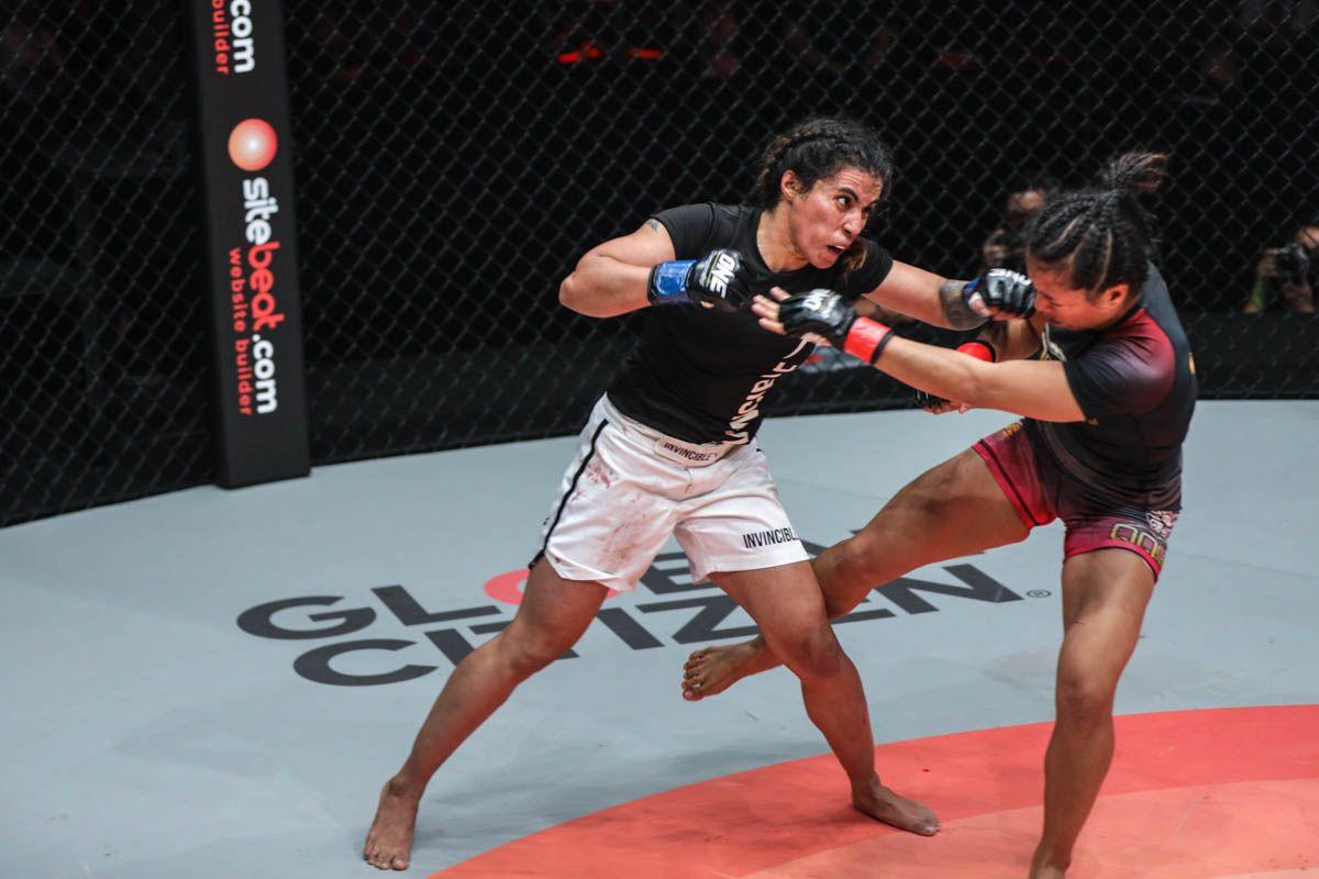 Indian martial artist Puja Tomar strikes Indonesia's Priscilla Hertati Lumban Gaol