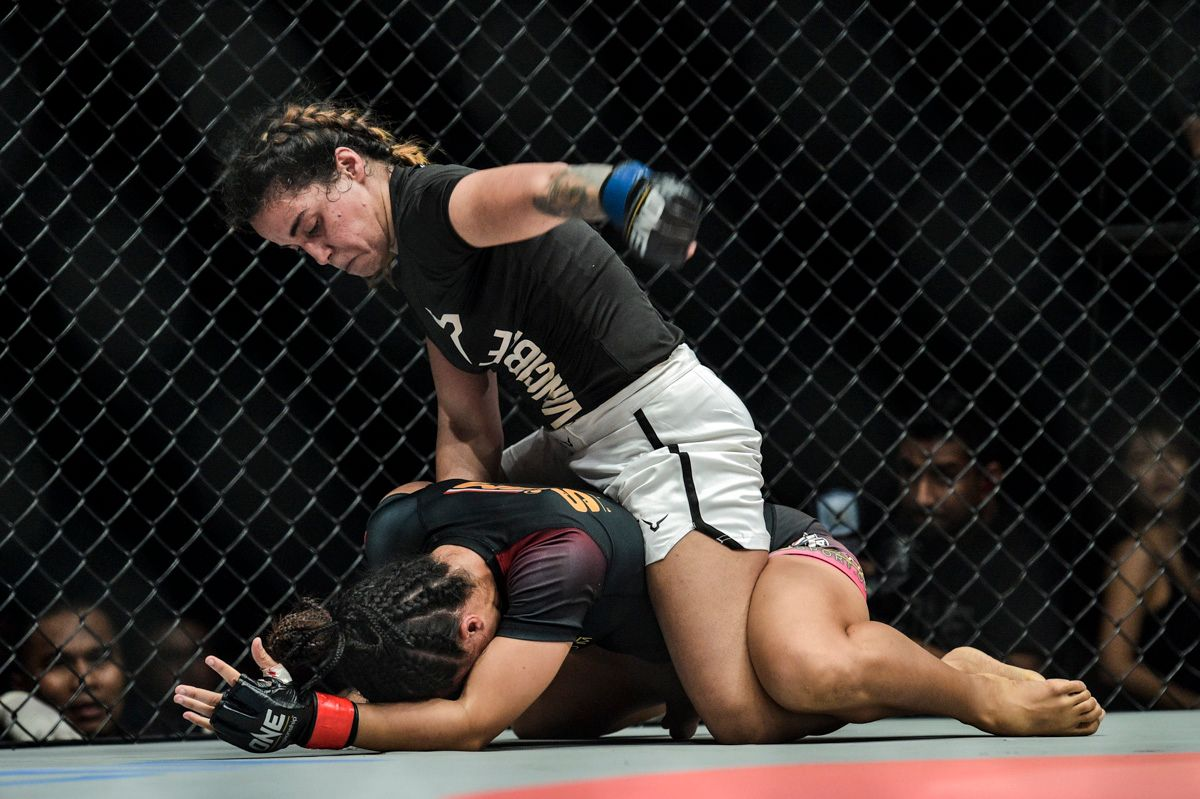 Indian Wushu Champion Puja Tomar unleashes ground and pound on Priscilla Hertati Lumban Gaol