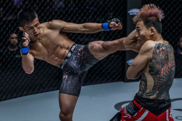 Chinese MMA fighter Tang Kai lands a head kick