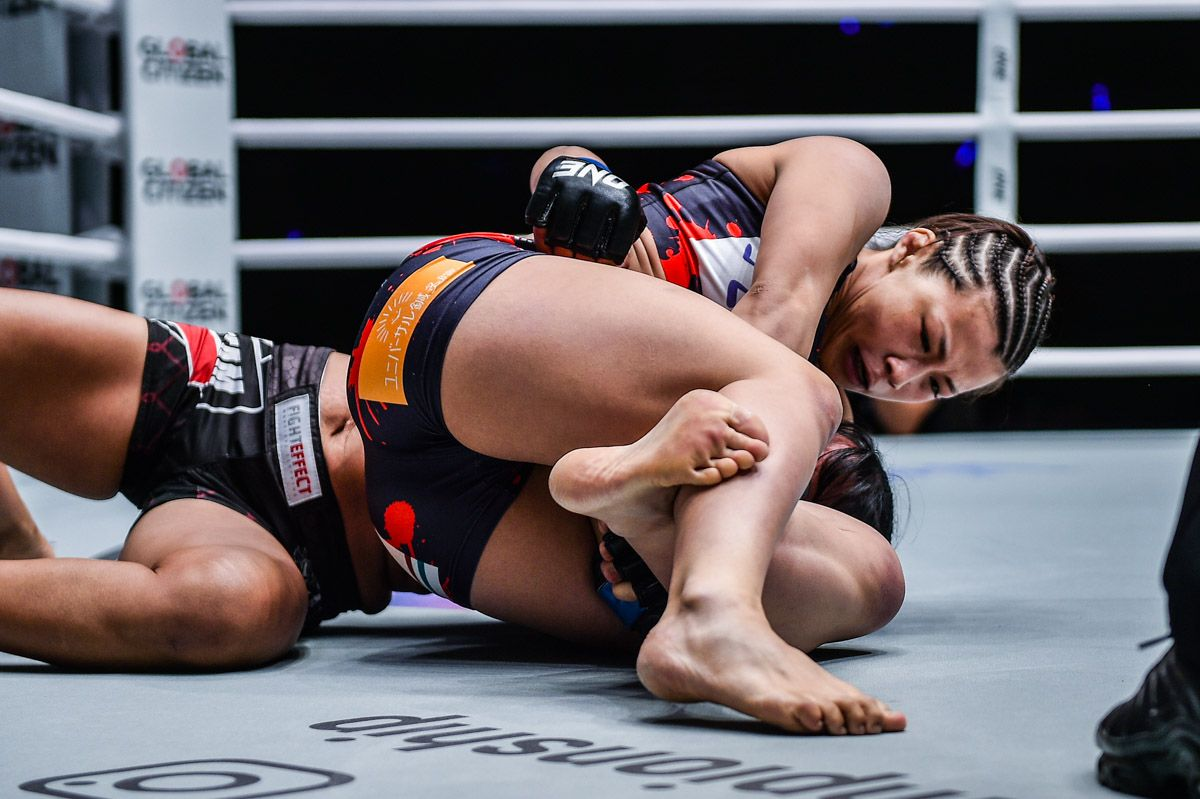 Japanese mixed martial artist Ayaka Miura locks up her trademark submission