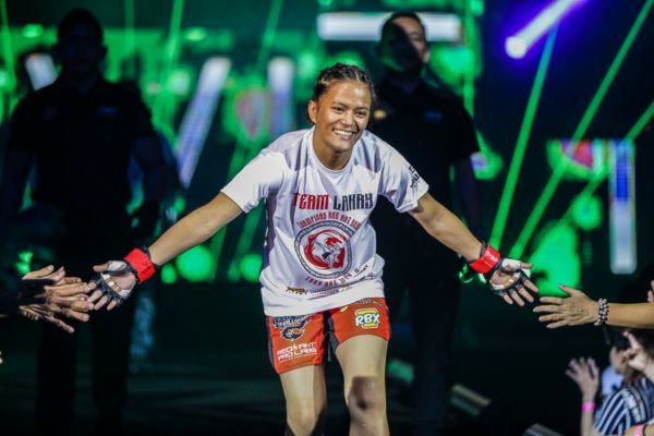 Philippine mixed martial arts warrior Gina Iniong enters the arena