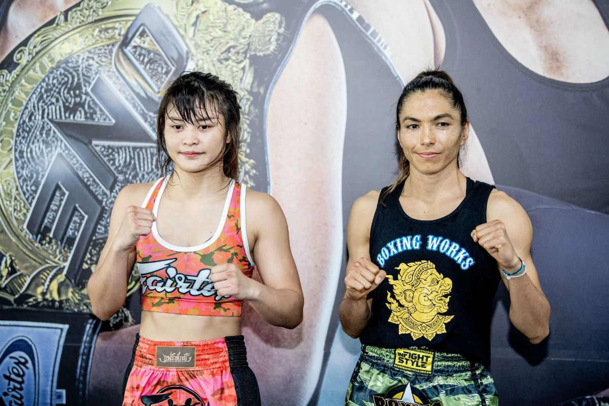 Thailand's Stamp Fairtex poses with American Muay Thai sensation Janet Todd